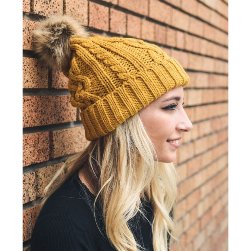 87467d2301f Hip Mustard Cable Knit Fur Pom Beanie